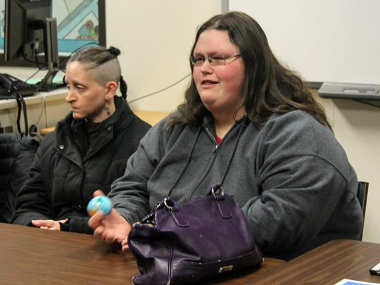 Westland residents Amanda Brown, right, and Caryn Hudson attend Monday's meeting on school safety in Westland.