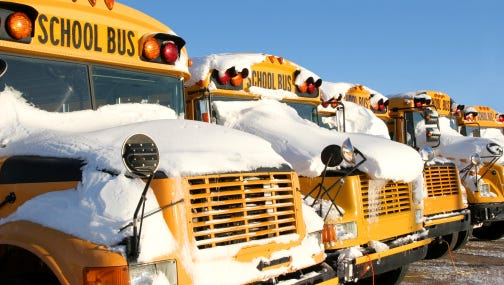 A stock image of snow on school buses.