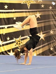 Alaina Ladaro performs gymnastics.