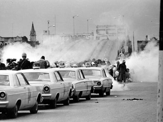 In this March 7, 1965, file photo, clouds of tear gas
