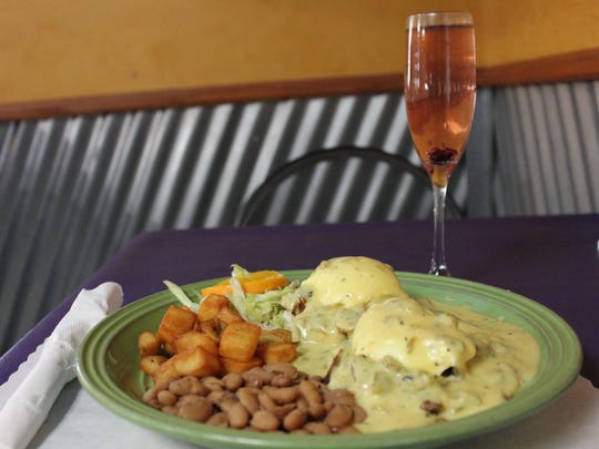 Cranberry champagne mimosa and Eggs Benedict with mushrooms and green chile hollandaise sauce, served with beans and potatoes at The Shed, 810 S. Valley Drive. The Eggs Benedict is one of the restaurant's more popular items.