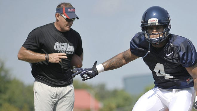 Ole Miss linebackers coach Tom Allen leads Denzel Nkemdiche through a drill in 2012. Allen has left the team for South Florida.