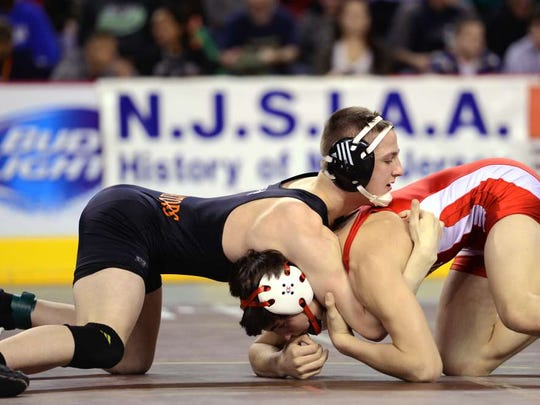 From 2016: Michael O'Malley of Hasbrouck Heights, on his way to defeating John Finnerty, of Pleasant Beach, in their 145-pound match during the state championship tournament in Atlantic City on March 5. O'Malley lost in his final match.