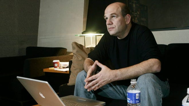 """David Simon works on additional dialogue recording for a new miniseries based on the Iraq and Afghanistan wars at Warner Bros. studios in Burbank, Calif., Wednesday, March 5, 2008. Simon is also the creator of """"The Wire,"""" an HBO show which endeavored unlike any previous fictional series to depict a city in full."""