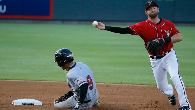 Sacramento River Cats center fielder Gorkys Hernandez attempts to slide into second base safely, but Chihuahuas shortstop Casey McElroy makes the tag and tries to make the double play. The two teams played the final game of the homestand and now the Chihuahuas will hit the road.