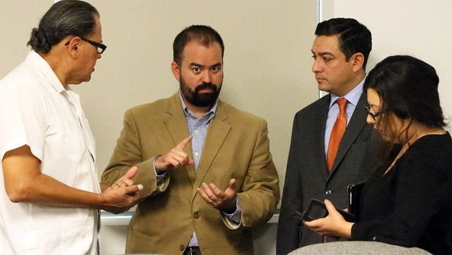 State Rep. Joe Moody, center and fellow El Paso state legislators gather to talk following Friday's Transportation Policy Board meeting for the El Paso Metropolitan Planning Organization in downtown El Paso. They are from left: Jose Rodriguez, Cesar Blanco and Mary Gonzalez.