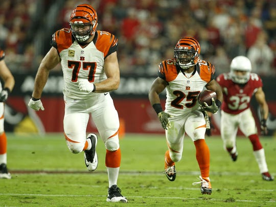 Cincinnati Bengals running back Giovani Bernard (25) runs upfield after making a catch as Cincinnati Bengals tackle Andrew Whitworth (77) leads the way this past season.