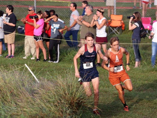 Veterans Memorial High School varsity boy Austin Vasquez (left) placed second overall and Alice High School varsity boy Matthew Lara placed third overall in the District 30-5A cross country meet at Dugan Track Stadium on Friday, October 13, 2017.