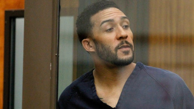 Former NFL football player Kellen Winslow Jr., looks through protective glass during his arraignment Friday in Vista, Calif.