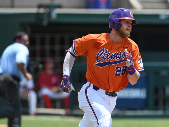 Clemson first baseman Seth Beer (28) rounds the bases after hitting a home run against St. John's during the top of the fourth inning of the NCAA Clemson Regional at Doug Kingsmore Stadium in Clemson Sunday, June 3, 2018.