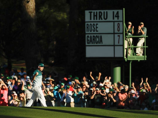 Sergio Garcia, of Spain, reacts after putting in for