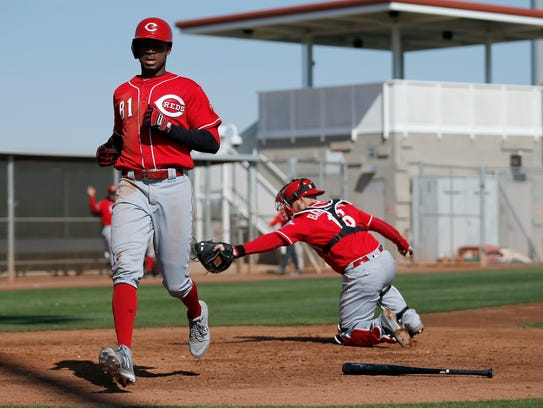 Reds outfielder Rossell Herrera (81) crosses the plate