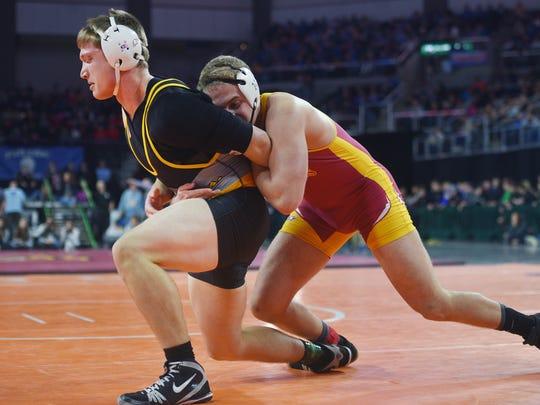 Mitchell's Carson Max wrestles Roosevelt's Joey Otta