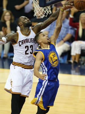 Cleveland Cavaliers forward LeBron James (23) blocks a shot by Golden State Warriors guard Stephen Curry (30) during the second half of Game 6 of basketball's NBA Finals in Cleveland, Thursday, June 16, 2016. (AP Photo/Ron Schwane)