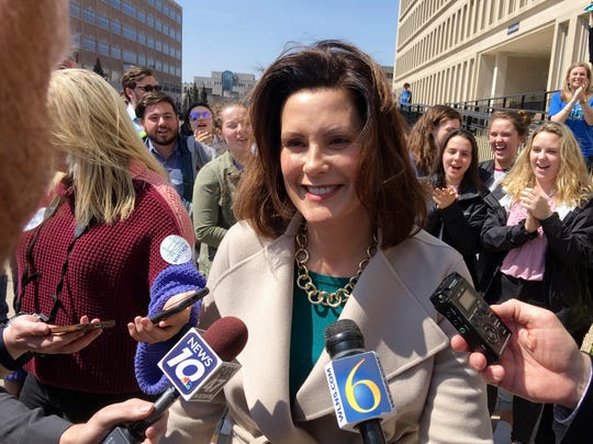FILE - In this April 12, 2018, file photo, newly elected Michigan governor Democrat Gretchen Whitmer speaks with reporters outside the state elections bureau in Lansing, Mich. (AP Photo/David Eggert, File)