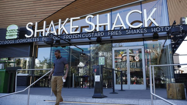 A Shake Shack restaurant is shown in front of the...