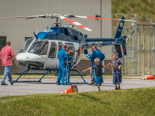Kids enjoy the site of a medical helicopter during the June 10 event at the Madison County Sheriff's Office.