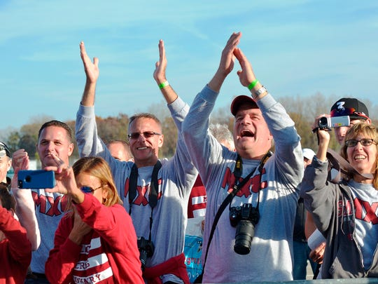 Milford fans celebrate at MIS after the girls cross country team won the MHSAA Division 1 title.