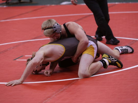 Steele Strout (Northridge) holds down Kyle Ice (Waynedale) Friday during the Division III state wrestling tournament