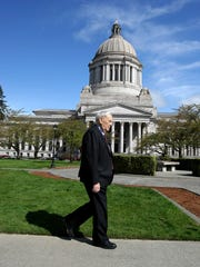 """2013 FILE Gordon Walgren a lawyer, lobbyist ,and past Washington State Senate majority leader, has a new book about his career in politics, called """" Close to the Flame.""""  He is walking on the grounds in Olympia.   LARRY STEAGALL / KITSAP SUN"""