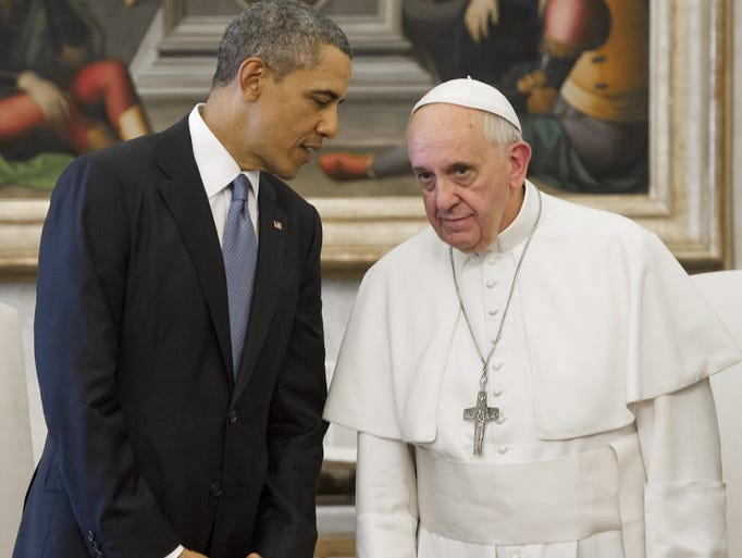 President Obama, left, speaks with Pope Francis during a private audience on March 27 at the Vatican.