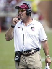 Florida State Seminoles head coach Jimbo Fisher makes a play call during the second half at Doak Campbell Stadium. The Florida State Seminoles defeat the Charleston Southern Buccaneers 52-8.