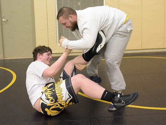 First-year North Farmington head coach Jon Castle believes his state-ranked heavyweight Zach Doran has what it takes to make the podium at the upcoming state finals.