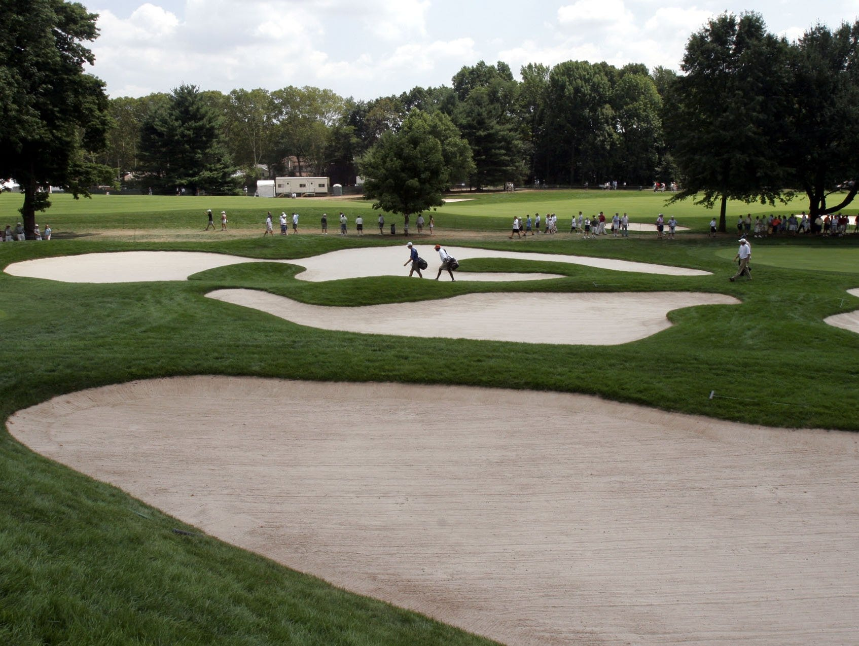 - -Text: Tbound in the center of the par 5, 650 yard, 17th hole at the 87th PGA Championship at the Baltusrol Golf Club in Springfield, New Jersey, August 10, 2005. ( Mark Vergari / The Journal News )