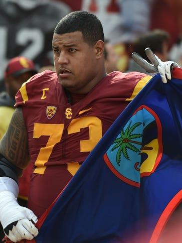USC Trojans offensive tackle Zach Banner carries a