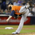 Astros starting pitcher Dallas Keuchel delivers against the Yankees on Tuesday in New York.