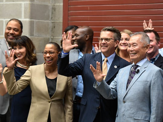George Takei (right) along with the Diversity Lecture Series board of directors show the Vulcan salute while taking a group photo before his talk at the Victory Theatre Tuesday, September 27, 2016.