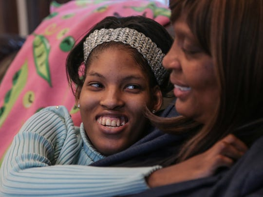Kiara Williamson, 23, of Southfield laughs with her