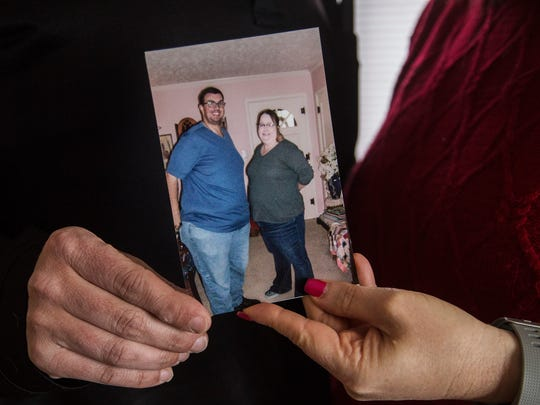 Chuck and Suzy Utech, of Ankeny, hold up a photo of