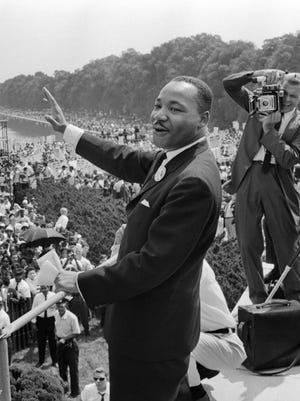 """The civil rights leader Martin Luther King waves to supporters in this Aug. 28, 1963, file photo, in Washington, D.C. The Washington Monument is seen in the background, during the """"March on Washington."""" King said the march was """"the greatest demonstration of freedom in the history of the United States."""""""
