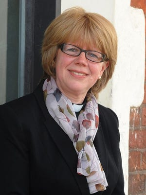 A handout photo made available by the Church of England Diocese of Exeter, showing Bishop Sarah Mullally, currently Bishop of Crediton, England, on June 9, 2015.