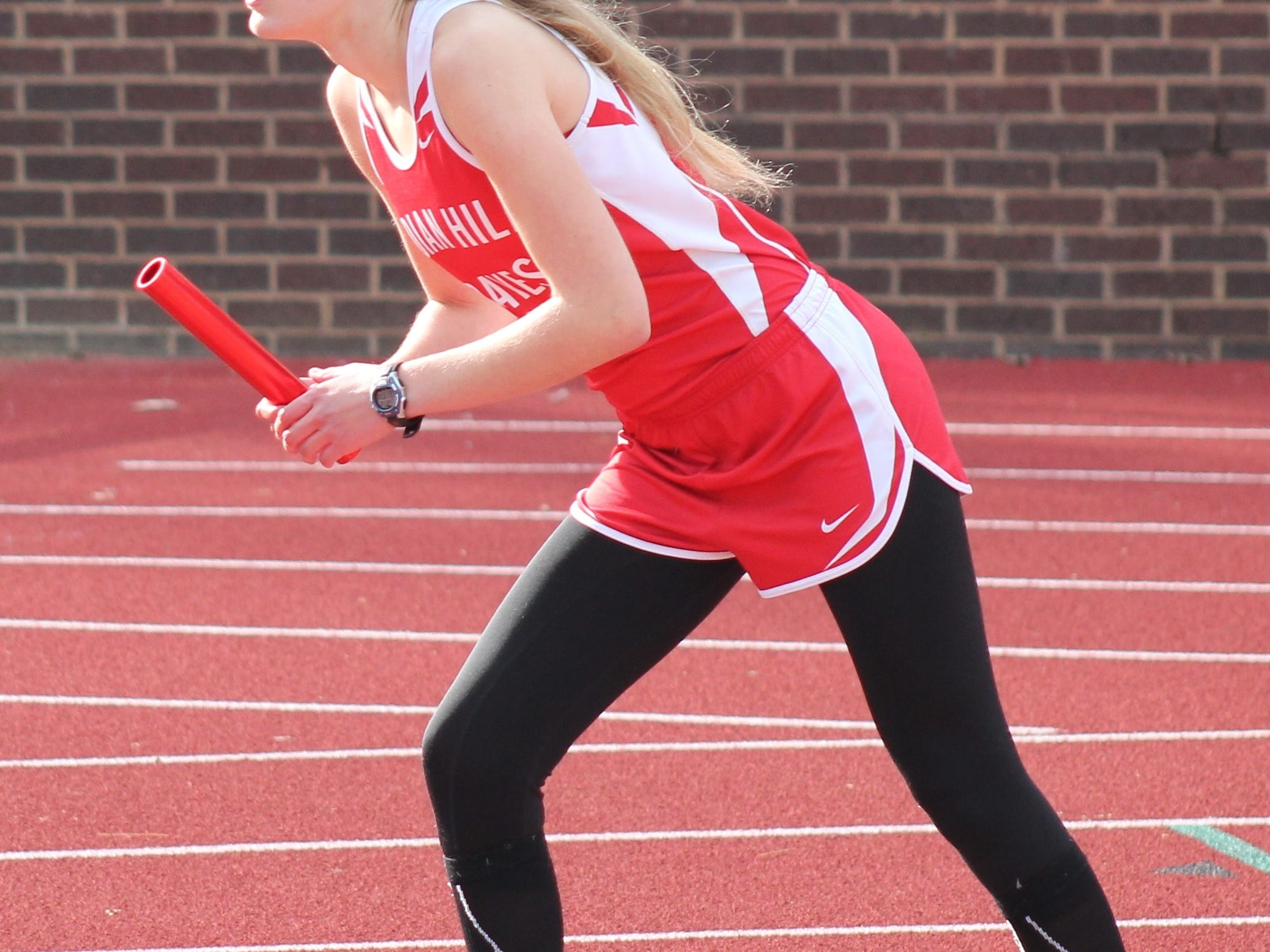 Sabrina Bulas awaits the start of the 4x800 relay for Indian Hill at the CHCA relays last season.