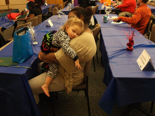 Whitney Reed holds her daughter Jaliyah Courtney after the Monroe County Nurse-Family Partnership graduation. Reed spent 30 months working one-on-one with a nurse from Visiting Nurse Service learning how to care for Jaliyah.
