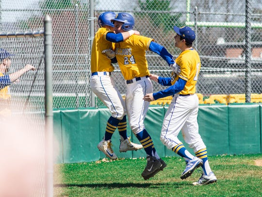 Butler's Derek Timpanaro (24) celebrates with teammates