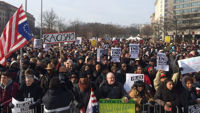 Protesters in Saturday's march in Washington, D.C., stream down Pennsylvania Avenue en route to the U.S. Capitol. The crowd was estimated at about 10,000 people.