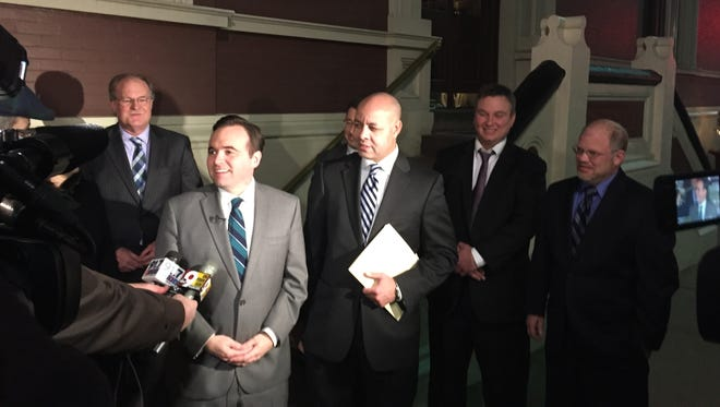 Mayor John Cranley (second from right) stands with City Manager Harry Black (middle) and city union officials outside the University Club  minutes before announcing the pension deal late Tuesday night.