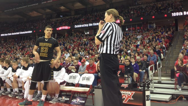 Menasha native Shelley Dietz became the first female official to referee a game at the WIAA boys' state tournament.