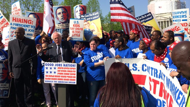 Sen. Bernie Sanders, I-Vt., speaks on Wednesday outside the U.S. Capitol building at a rally for federal contract who went on strike to protest low wages.