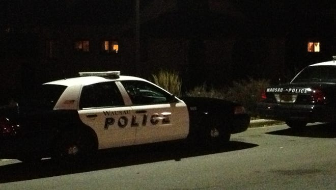 Wausau police were searching Monday for two men who robbed a couple at knifepoint on Sunday night in Riverside Park.