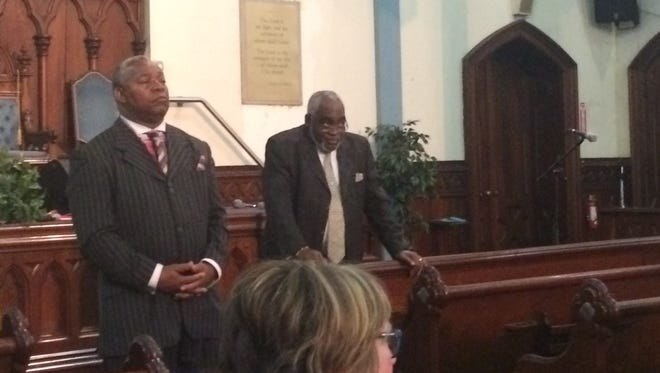 Local church leaders Clifford Florence, Sr., left, and Willie F. Davis, Jr., speak to about 75 people at Central Church of Christ, 101 South Plymouth Ave.