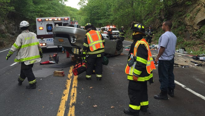 North White Plains, and Valhalla firefighters work at a one-car rollover on Route 22 south in North White Plains on May 14, 2015. The driver was transported to Westchester Medical Center with minor injuries. Southbound lanes were closed for about a half hour.