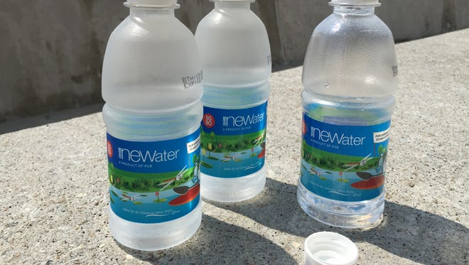 """Bottles of NEWater, recycled sewage water that is given away in Singapore to help the public get over the """"yuck"""" factor for what the nation hopes will become a major component of its water supply."""