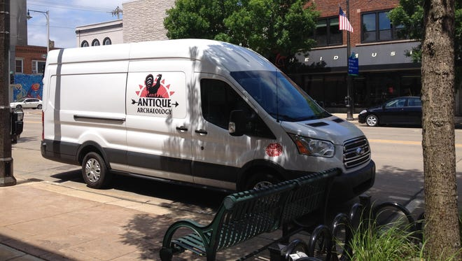 "The ""American Pickers"" Antique Archaeology van was parked in downtown Appleton on Sunday."