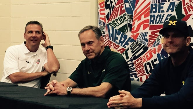 Ohio State football coach Urban Meyer, left, Michigan State coach Mark Dantonio, center, and Michigan coach Jim Harbaugh speak Friday, June 12, 2015, at Macomb Dakota