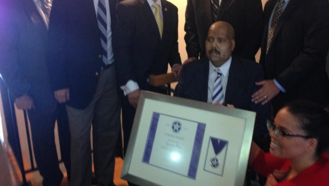 Deputy U.S. Marshal Zacarias Toro, seated, was awarded the U.S. Marshals Service's Purple Heart award just a week before his death.