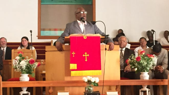 Pastor Everett Newton at a vigil Sunday at Spring Valley's First Baptist Church in honor of the nine people shot and killed last week in Charleston.